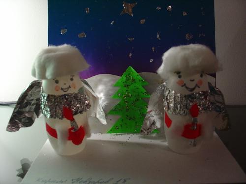 """Делали из пустых бутылочек от  """"Актимеля """".  Крылья, воротнички, свечки - фольга, Руки и огонек свечи - цветная бумага..."""