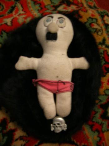 А это её любимый Фюрер, она с ним спит! (а черная с черепом - любимая шапка!)
