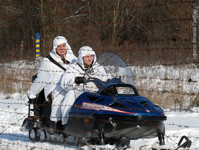 Ukrainian border guards patrol on snowmobile at the Ukraine-Romanian border near the village of Yablunivka, 300 kilometers (186 miles) from Lviv, February 4, 2010. phot.: Vitaliy Hrabar