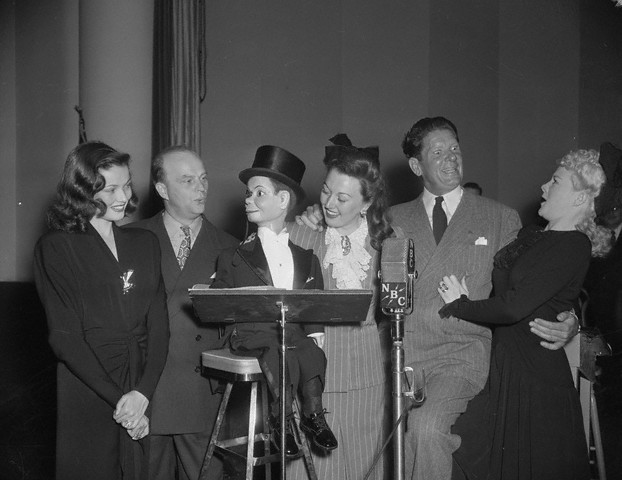 The USO in WWII Gene-Tierney_-Edgar-Bergen_-Ginny-Sims_-Bob-Burns_-Gary-Cooper-and-Betty-Hutton-inaugurating-a-shortwave-program-for-soldiers_-August-1942