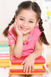 ist2_8161193-laughing-girl-with-book