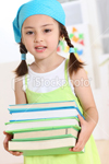 ist2_8165616-girl-hold-textbooks