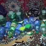 Криминал: Милиция Житомира изъяла у пенсионерки 14 полторалитровых бутылок с самогоном. ФОТО