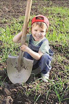 Little boy with big shovel